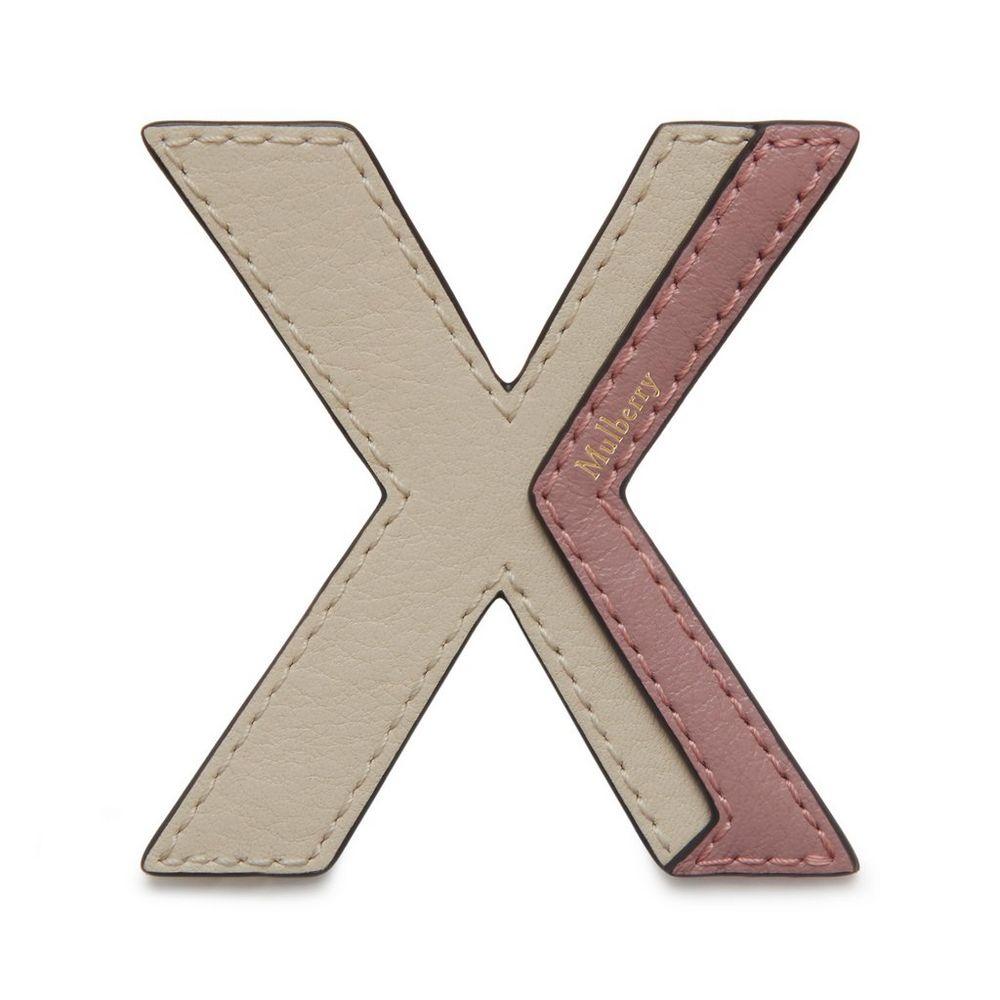 bi-colour-leather-sticker---x